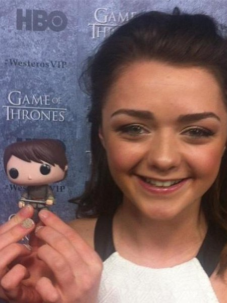 Maisie Williams holding her pop figure